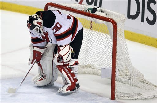 New Jersey Devils' goalie Martin Brodeur (30) reacts after stopping another Florida Panthers shot on-goal during the second period of Game 5 in a first-round NHL Stanley Cup playoff hockey series in Sunrise, Fla., Saturday, April 21, 2012. (AP Photo/J Pat Carter)