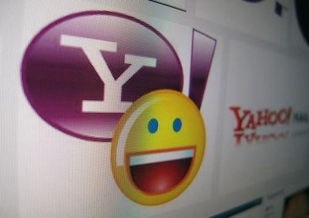 A Yahoo logo is displayed on a monitor in this photo illustration in Encinitas, California, April 16, 2013. REUTERS/Mike Blake/File Photo