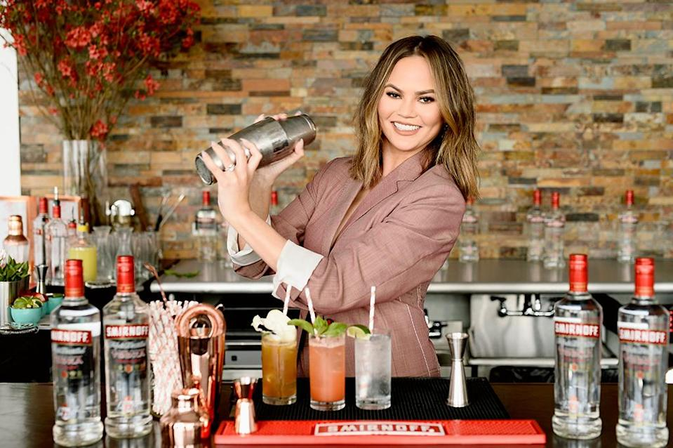 """<p>The social media maven mixed up cocktails at a New York City event for Smirnoff No. 21, where <a rel=""""nofollow"""" href=""""https://www.yahoo.com/celebrity/chrissy-teigen-reveals-john-legend-175044303.html"""" data-ylk=""""slk:she also mused on hangover cures;outcm:mb_qualified_link;_E:mb_qualified_link;ct:story;"""" class=""""link rapid-noclick-resp yahoo-link"""">she also mused on hangover cures</a>. """"I think as long as you [drink] in moderation, that's the only cure — because everything else is bulls***,"""" she said. """"There's no real trick, there's no powder."""" (Photo: Dave Kotinsky/Getty Images for SMIRNOFF) </p>"""