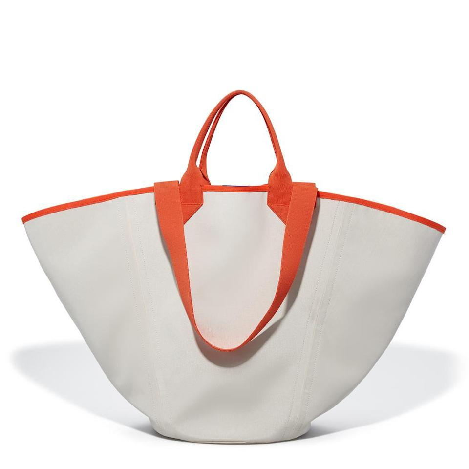 "Not only is this XXL tote sturdy and machine washable, the brand is also <a href=""https://www.glamour.com/story/meghan-markle-rothys-handbags?mbid=synd_yahoo_rss"" rel=""nofollow noopener"" target=""_blank"" data-ylk=""slk:Meghan Markle–certified"" class=""link rapid-noclick-resp"">Meghan Markle–certified</a>. $175, Rothys. <a href=""https://rothys.com/bags/products/the-reversible-tote?color=white-%26-navy"" rel=""nofollow noopener"" target=""_blank"" data-ylk=""slk:Get it now!"" class=""link rapid-noclick-resp"">Get it now!</a>"