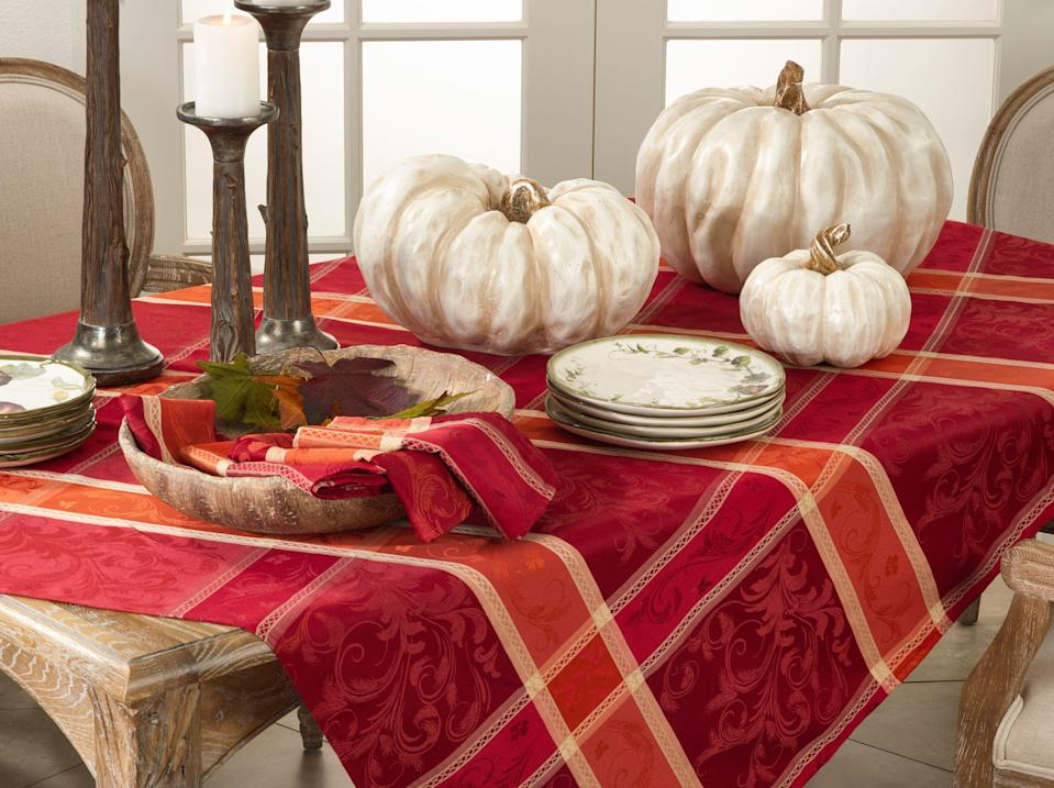 "<p>birchlane.com</p><p><strong>$24.00</strong></p><p><a href=""https://go.redirectingat.com?id=74968X1596630&url=https%3A%2F%2Fwww.birchlane.com%2Fkitchen-dining%2Fpdp%2Fsensabaugh-plaid-tablecloth-b000723604.html%3Fpiid%3D1454734969&sref=https%3A%2F%2Fwww.countryliving.com%2Fentertaining%2Fg33394439%2Fthanksgiving-tablecloths%2F"" rel=""nofollow noopener"" target=""_blank"" data-ylk=""slk:Shop Now"" class=""link rapid-noclick-resp"">Shop Now</a></p><p>Warm up your Thanksgiving table with a bold plaid tablecloth in the colors of fall. Bright reds and oranges will ensure that your Thanksgiving table makes a statement this year.<br></p>"