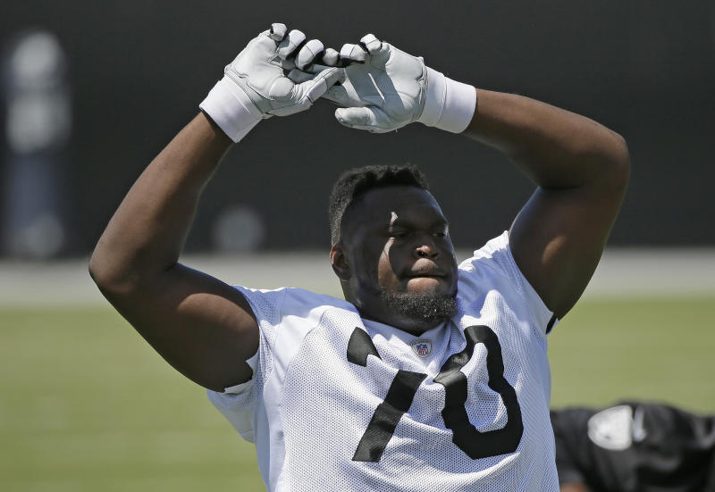 Oakland Raiders tackle Kelechi Osemele stretches during their football minicamp Tuesday, June 14, 2016, in Alameda, Calif. (AP Photo/Eric Risberg)