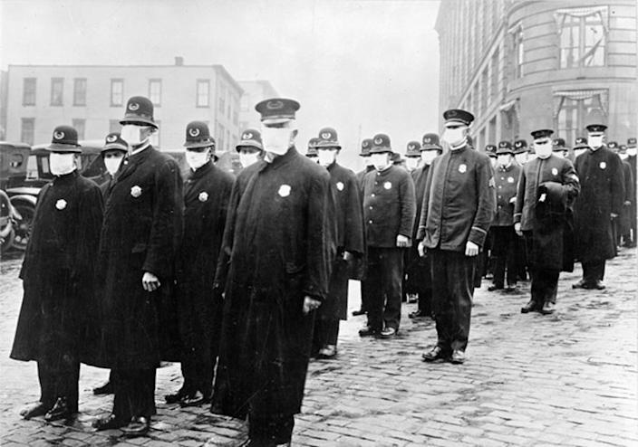 """<span class=""""caption"""">Policemen in Seattle, Washington, wearing masks made by the Red Cross, during the influenza pandemic, December 1918</span> <span class=""""attribution""""><a class=""""link rapid-noclick-resp"""" href=""""https://catalog.archives.gov/id/45499339"""" rel=""""nofollow noopener"""" target=""""_blank"""" data-ylk=""""slk:National Archives"""">National Archives</a></span>"""