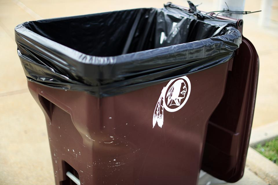 A trash can featuring the old Washington Redskins logo that has since been retired.