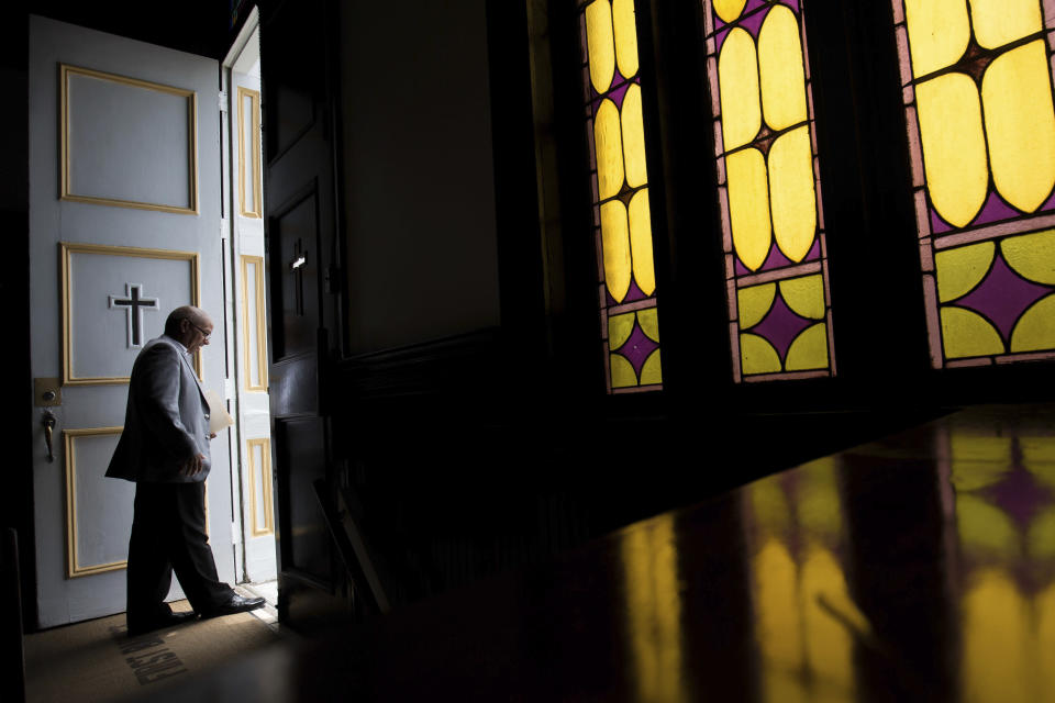 FILE - In this Sunday, July 10, 2016 file photo, a parishioner at First Baptist Church, a predominantly African-American congregation, leaves after a worship service in Macon, Ga. According to a Pew study released on Tuesday, Feb. 16, 2021, Black Americans attend church more regularly than Americans overall, and pray more often. Most of them attend churches that are predominantly Black -- yet many would like those congregations to become racially diverse. (AP Photo/Branden Camp)