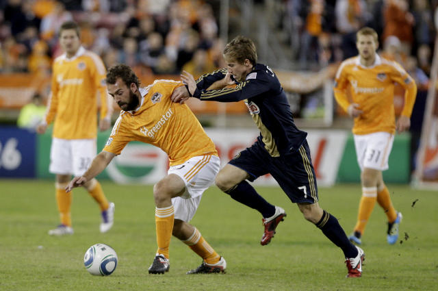 HOUSTON, TX - NOVEMBER 03: Adam Moffat #16 of the Houston Dynamo shields the ball from Brian Carroll #7 of the Philadelphia Union in the second leg of the playoffs on November 3, 2011 at Robertson Stadium in Houston, Texas. The Dynamo won 1 to 0 and will play the Sporting K.C. Sunday, November 6, 2011. (Photo by Thomas B. Shea/Getty Images)