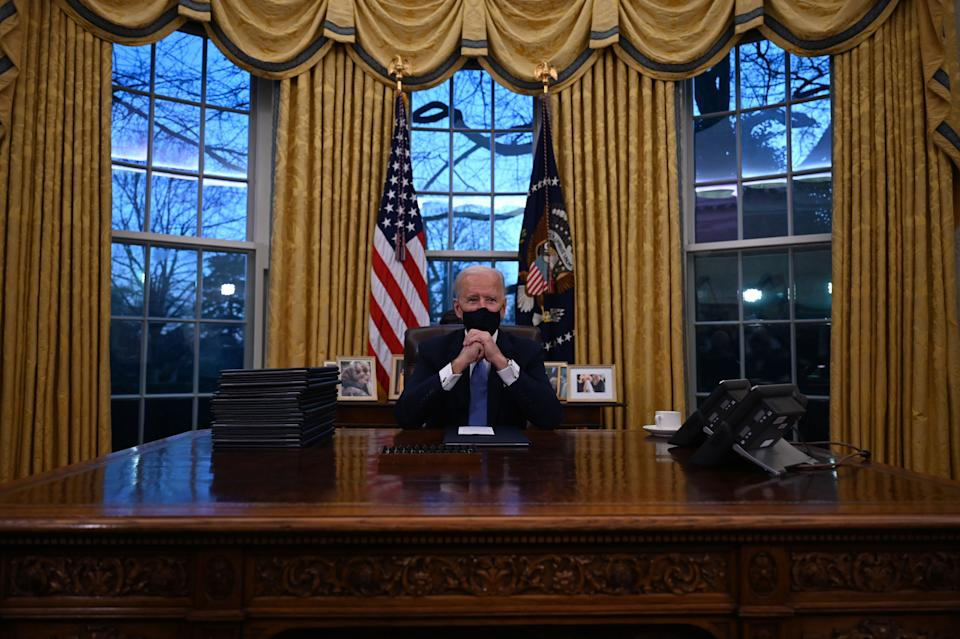 US President Joe Biden sits in the Oval Office at the White House in Washington, DC, after being sworn in at the US Capitol on January 20, 2021. (Photo by Jim WATSON / AFP) (Photo by JIM WATSON/AFP via Getty Images) (Photo: JIM WATSON via Getty Images)