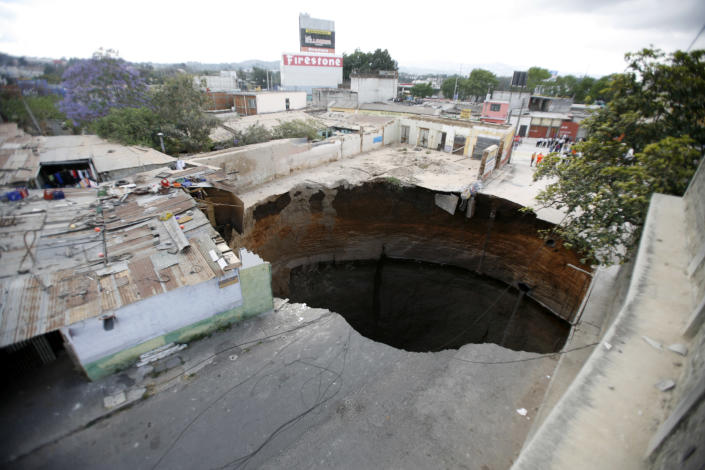 A giant sinkhole that swallowed several homes is seen in Guatemala City February 23, 2007. REUTERS/Daniel LeClair