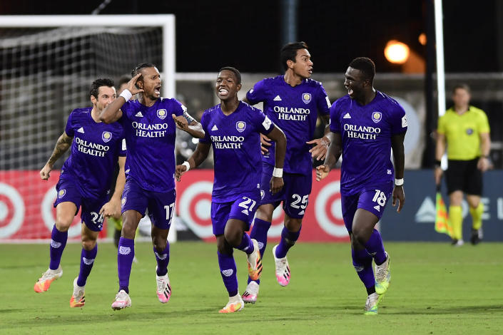 Orlando City players celebrate their penalty shootout upset of Los Angeles FC Friday in the quarterfinals of the MLS is Back Tournament. (Emilee Chinn/Getty Images)