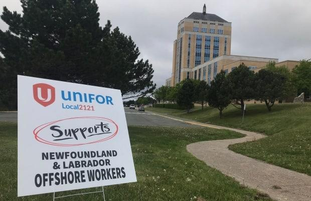 Unifor, which represents workers in the Terra Nova oilfield, rallies outside Confederation Building on Monday as an emergency debate is held in the House of Assembly. (Terry Roberts/CBC - image credit)