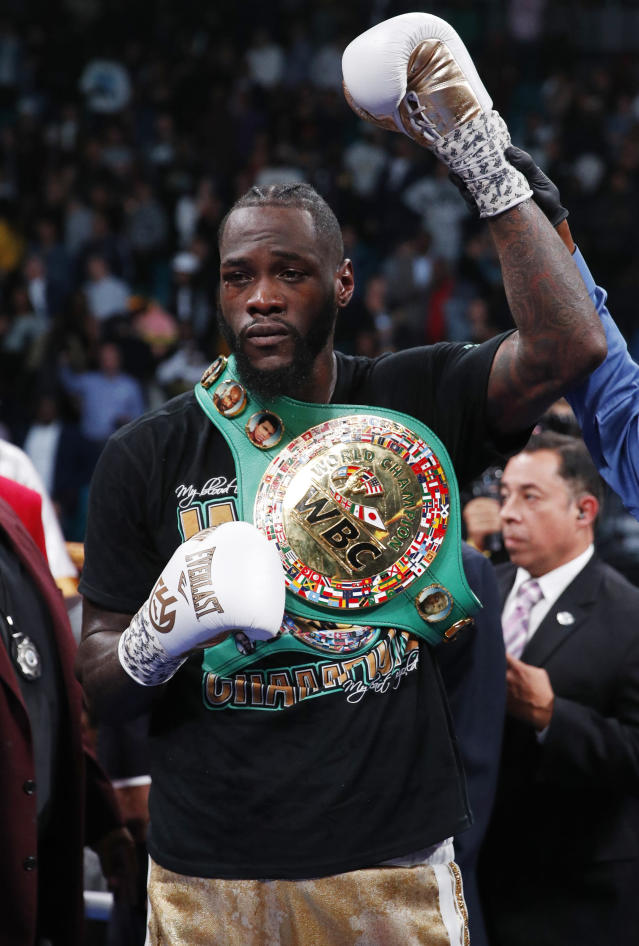 Deontay Wilder poses for photographers after defeating Luis Ortiz in the WBC heavyweight title boxing match Saturday, Nov. 23, 2019, in Las Vegas. (AP Photo/John Locher)