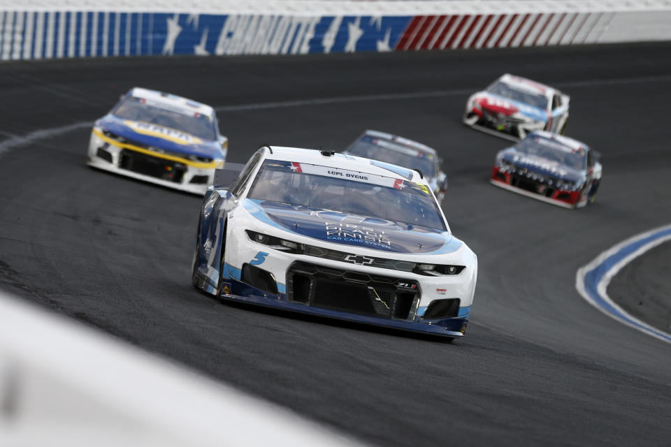 CONCORD, NORTH CAROLINA - MAY 30: Kyle Larson, driver of the #5 Metro Tech Chevrolet, leads the field during the NASCAR Cup Series Coca-Cola 600 at Charlotte Motor Speedway on May 30, 2021 in Concord, North Carolina. (Photo by Brian Lawdermilk/Getty Images)