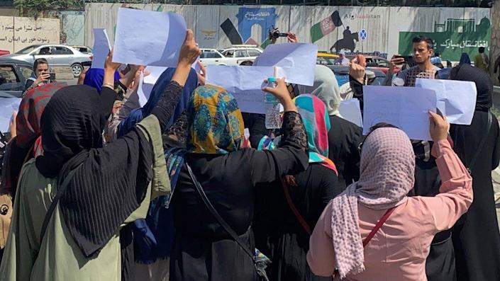 Afghan women hold placards as they call on the Taliban to preserve their rights to work and an education, in Kabul, on 3 September 2021