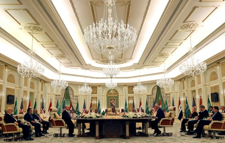 Saudi King Salman bin Abdulaziz (C) attends a meeting of the Saudi-Iraqi Bilateral Coordination Council with US Secretary of State Rex Tillerson (C-R) and Iraqi Prime minister Haider al-Abadi (C-L), in the Saudi capital Riyadh on October 22, 2017