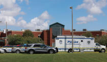 Newport News Police are on the scene at Heritage High School responding to a shooting incident Monday, Sept. 20, 2021 in Newport News, Va. (Kaitlin McKeown/The Virginian-Pilot via AP)