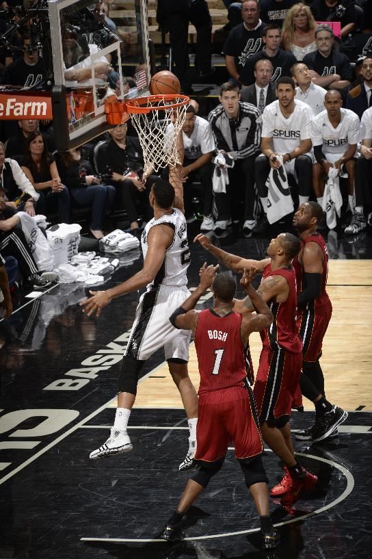 SAN ANTONIO, TX - June 5: Tim Duncan #21 of the San Antonio Spurs shoots against Chris Bosh #1 of the Miami Heat in Game One of the 2014 NBA Finals on June 5, 2014 at the AT&T Center in San Antonio, Texas. (Photo by D. Clarke Evans/NBAE via Getty Images)
