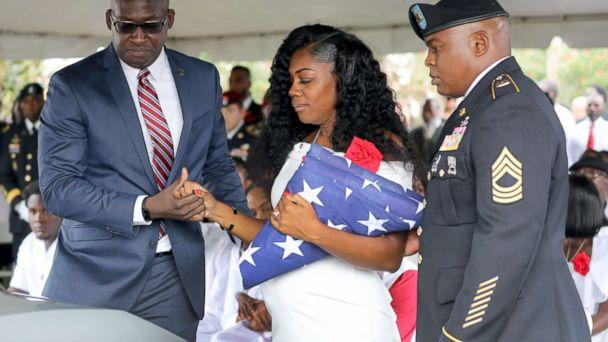 PHOTO: Myeshia Johnson, the wife of Army Sgt. La David Johnson, looks down at his casket after the burial at Hollywood Memorial Gardens, Oct. 21, 2017, in Ft. Lauderdale, Fla. (Mike Stocker/South Florida Sun-Sentinel/Polaris)