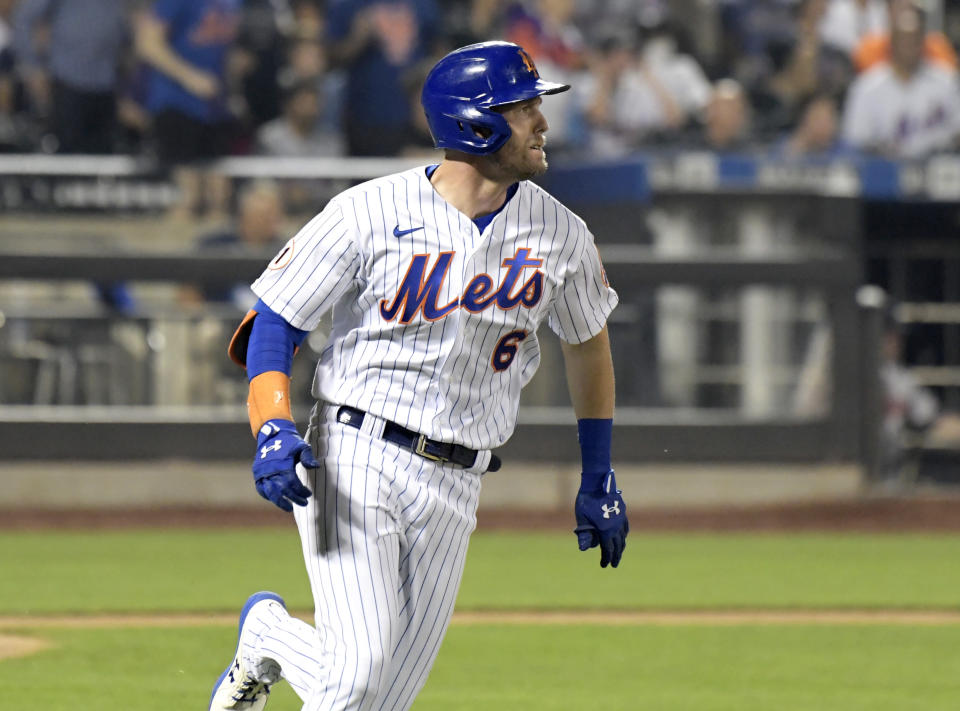 New York Mets' Jeff McNeil runs after hitting an RBI-double, scoring Brandon Nimmo, in the fifth inning of the second game of a baseball doubleheader against the Atlanta Braves, Monday, July 26, 2021, in New York. (AP Photo/Bill Kostroun)