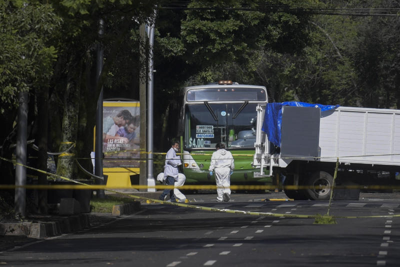 Experts work at the crime scene after Mexico City's Public Security Secretary Omar Garcia Harfuch was wounded in an attack in Mexico City, on June 26, 2020. - Mexico City's security chief was wounded in a gun attack Friday in which two of his bodyguards and a woman passerby were killed, Mayor Claudia Sheinbaum said. (Photo by PEDRO PARDO / AFP) (Photo by PEDRO PARDO/AFP via Getty Images)