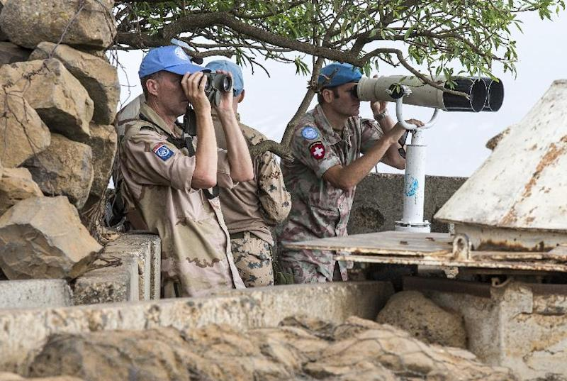 European members of the UN Disengagement Observer Force in the Israeli-occupied Golan Heights keep watch on the Syrian side on August 29, 2014 after rebel fighters took control of the Quneitra border crossing