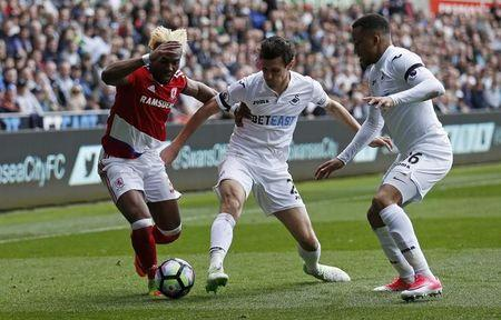 Britain Football Soccer - Swansea City v Middlesbrough - Premier League - Liberty Stadium - 2/4/17 Swansea City's Jack Cork and Martin Olsson in action with Middlesbrough's Adama Traore  Action Images via Reuters / Andrew Boyers Livepic