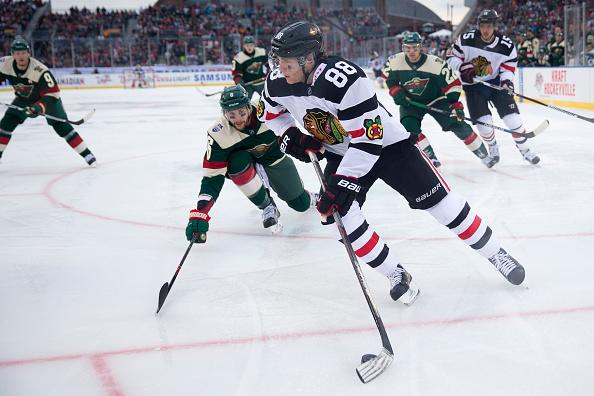 9227be89182 Chicago Blackhawks right wing Patrick Kane (88) aims for the Wild's net  during the