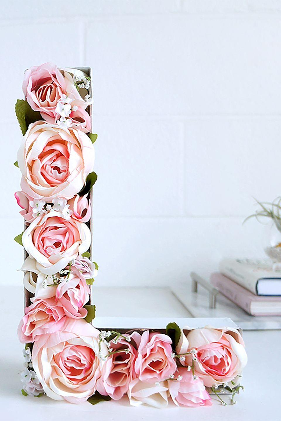 """<p>This flower-filled monogram letter will add a delicate touch to any room in your house. </p><p><strong>Get the tutorial at <a href=""""http://blog.lulus.com/general/blooming-monogram-diy/"""" rel=""""nofollow noopener"""" target=""""_blank"""" data-ylk=""""slk:Lulu's"""" class=""""link rapid-noclick-resp"""">Lulu's</a>.</strong> </p><p><strong><a class=""""link rapid-noclick-resp"""" href=""""https://www.amazon.com/Paper-Mache-Letter-X5-1-Letter/dp/B0054G5UC8?tag=syn-yahoo-20&ascsubtag=%5Bartid%7C10050.g.2971%5Bsrc%7Cyahoo-us"""" rel=""""nofollow noopener"""" target=""""_blank"""" data-ylk=""""slk:SHOP LETTERS"""">SHOP LETTERS</a><br></strong></p>"""