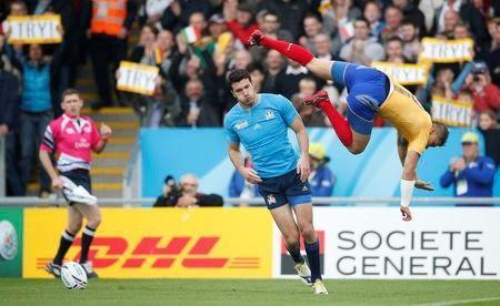 Rugby Union - Italy v Romania - IRB Rugby World Cup 2015 Pool D - Sandy Park, Exeter, England - 11/10/15 Leonardo Sarto after scoring the first try for Italy as Romania's Vali Calafeteanu jumps over him Action Images via Reuters / Andrew Couldridge
