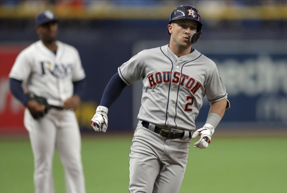 Houston Astros' Alex Bregman rounds the bases after hitting a solo home run during the first inning of a baseball game against the Tampa Bay Rays Saturday, March 30, 2019, in St. Petersburg, Fla. (AP Photo/Mike Carlson)