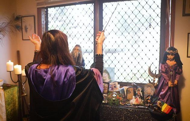 Mara performs a spell in her home. Photo: Be
