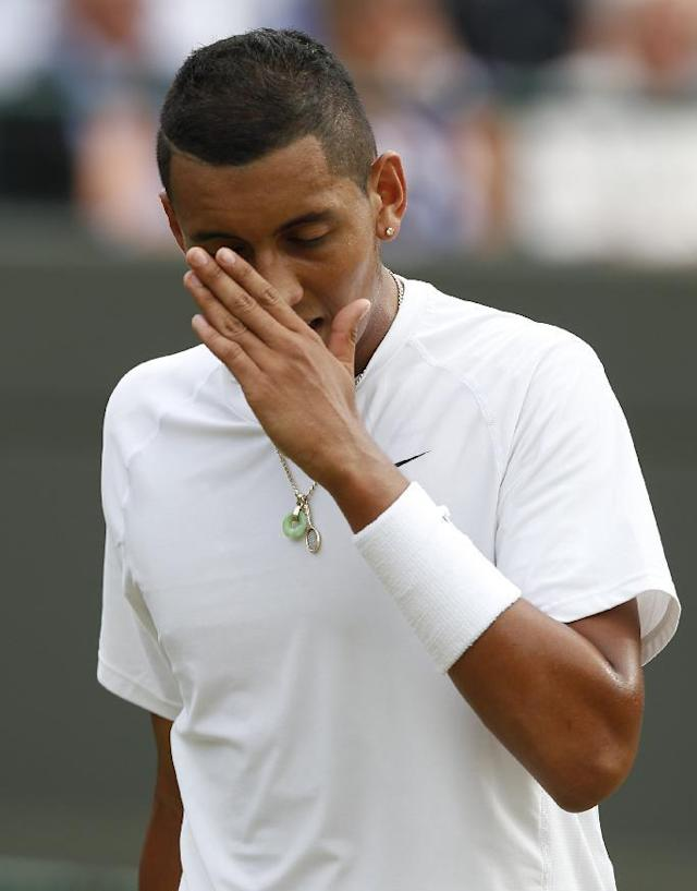 Nick Kyrgios of Australia reacts after losing a point to Milos Raonic of Canada during their men's singles quarterfinal match at the All England Lawn Tennis Championships in Wimbledon, London, Wednesday, July 2, 2014. (AP Photo/Ben Curtis)