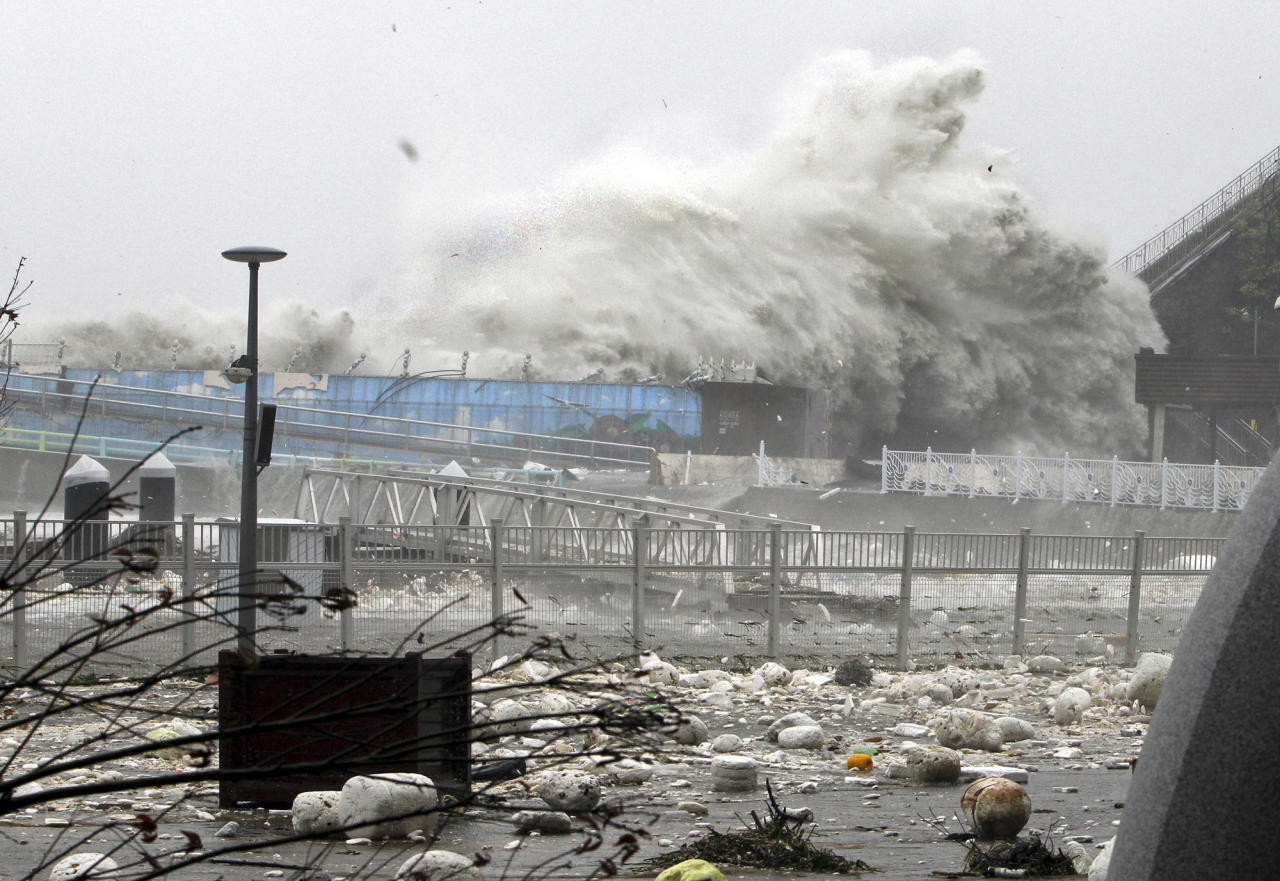 High waves, caused by Typhoon Sanba, crash on a seaside road in Yeosu, south of Seoul, South Korea, Monday, Sept. 17, 2012. (AP Photo/Yonhap, Hyung Min-soo) KOREA OUT