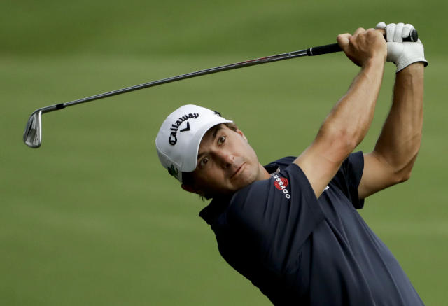 Kevin Kisner hits from the fairway on the 18th hole during the first round of the PGA Championship golf tournament at the Quail Hollow Club Thursday, Aug. 10, 2017, in Charlotte, N.C. (AP Photo/Chris O'Meara)