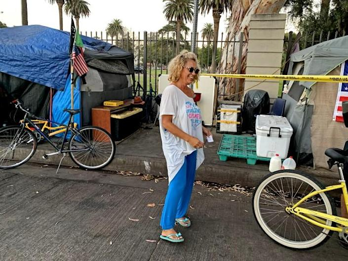 BRENTWOOD, CALIF. - SEPT. 15, 2021 - Shalise Garcia, also known as Coco, a resident of the encampment outside the grounds of the VA on San Vicente Blvd. in the Los Angeles neighborhood of Brentwood on Sept. 15, 2021, hours after a resident of the camp was fatally stabbed. (Carla Hall / Los Angeles Times)