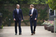 Britain's Prince William and Prince Harry arrive for the statue unveiling on what would have been Princess Diana's 60th birthday, in the Sunken Garden at Kensington Palace, London, Thursday July 1, 2021. (Yui Mok/Pool Photo via AP)