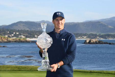 February 12, 2017; Pebble Beach, CA, USA; Jordan Spieth poses with the trophy on the 18th green during the final round of the AT&T Pebble Beach Pro-Am golf tournament at Pebble Beach Golf Links. Mandatory Credit: Kyle Terada-USA TODAY Sports