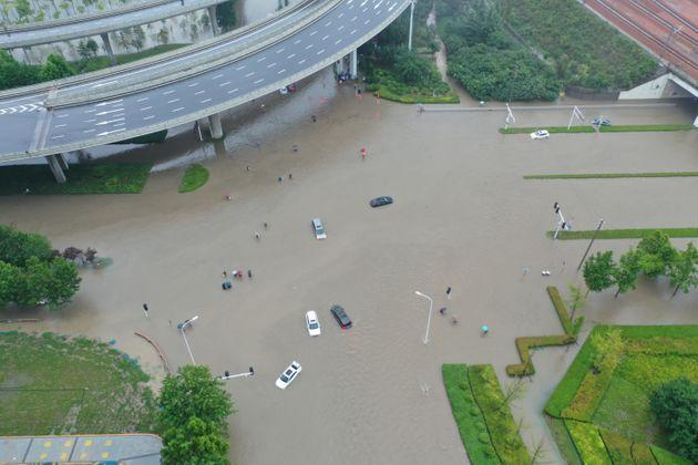 ZHENGZHOU, CHINA - JULY 20: Aerial view of vehicles stranded in floodwater on July 20, 2021 in Zhengzhou, Henan Province of China. Torrential rains hit Henan since July 16, causing floods in many parts of the province on Monday and Tuesday. (Photo by Jiao Xiaoxiang/VCG via Getty Images) (Photo: VCG via Visual China Group via Getty Ima)