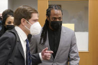 NFL football player Richard Sherman, right, heads into a hearing at King County District Court with his attorney Cooper Offenbecher, Friday, July 16, 2021, in Seattle. Prosecutors in Washington state have charged Sherman, who has played for the Seattle Seahawks and the San Francisco 49ers NFL football teams, after police said he drunkenly crashed his SUV in a construction zone and tried to break into his in-laws' home. (AP Photo/Ted S. Warren)