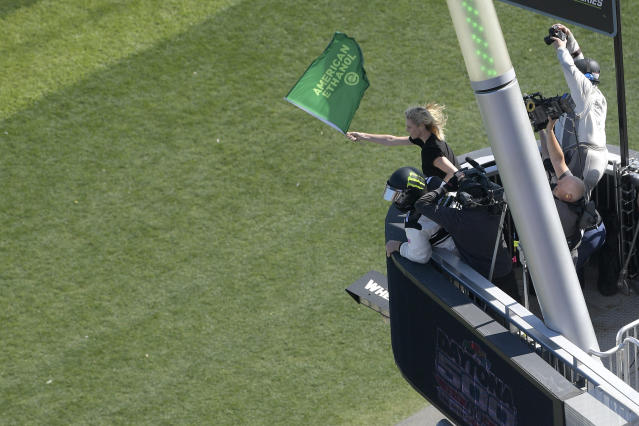 Charlize Theron waves the green flag as drivers approach the start of the Daytona 500 on Feb. 18 in Florida. (Photo: AP/Phelan M. Ebenhack)