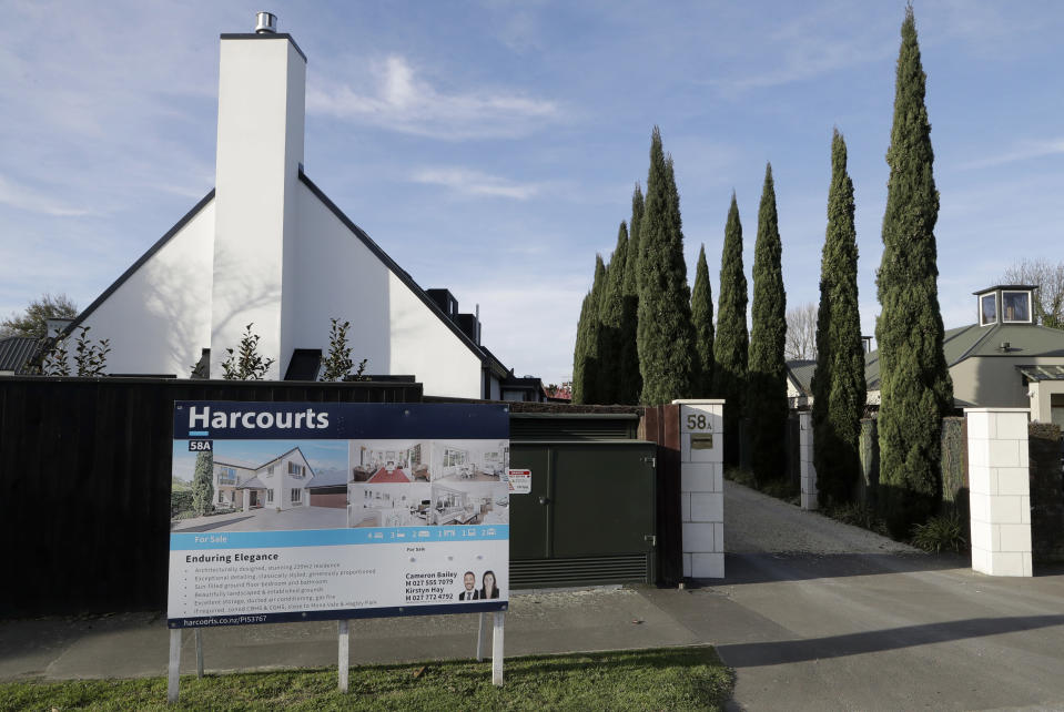 FILE - In this Aug. 13, 2018, file photo a house is pictured for sale in Christchurch, New Zealand. New Zealand's government on Thursday, Feb. 25, 2021 made the first of several promised moves to rein in skyrocketing house prices by ordering the nation's Reserve Bank to consider the impact on housing when making decisions. (AP Photo/Mark Baker, File)