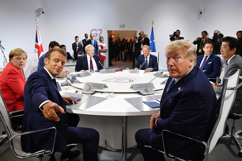 BIARRITZ, FRANCE - AUGUST 25: France's President Emmanuel Macron and US President Donald Trump pose for the media as they meet for the first working session of the G7 Summit on August 25, 2019 in Biarritz, France. The French southwestern seaside resort of Biarritz is hosting the 45th G7 summit from August 24 to 26. High on the agenda will be the climate emergency, the US-China trade war, Britain's departure from the EU, and emergency talks on the Amazon wildfire crisis. (Photo by Jeff J Mitchell - Pool /Getty Images)