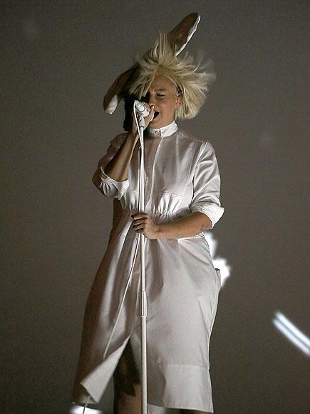Sia Revealed! Singer Accidentally Shows Her Face During Concert| Sia