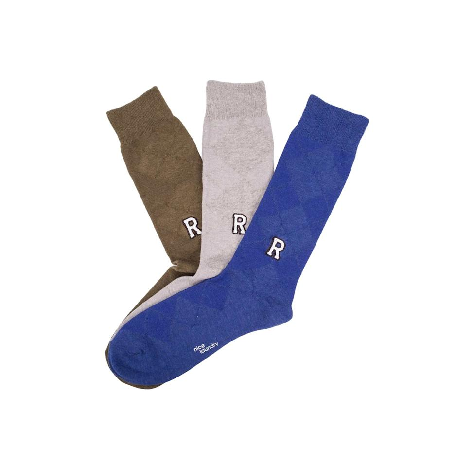 "<p>No more guessing games on laundry day. Ensure that his housemates stop ""borrowing"" his socks by monogramming each pair. Choose from three embroidery styles.</p> <p><strong>To buy:</strong> $45; <a href=""https://www.nicelaundry.com/products/personal-edition-luxe"" target=""_blank"">nicelaundry.com</a>.</p>"
