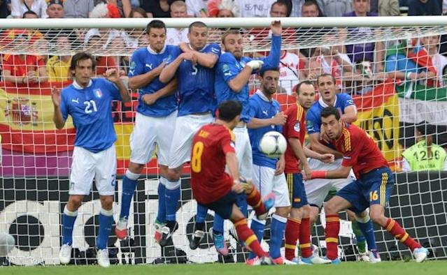 Spanish midfielder Xavi Hernandez (C) performs a free kick during the Euro 2012 championships football match Spain vs Italy on June 10, 2012 at the Gdansk Arena. AFPPHOTO/ GIUSEPPE CACACEGIUSEPPE CACACE/AFP/GettyImages