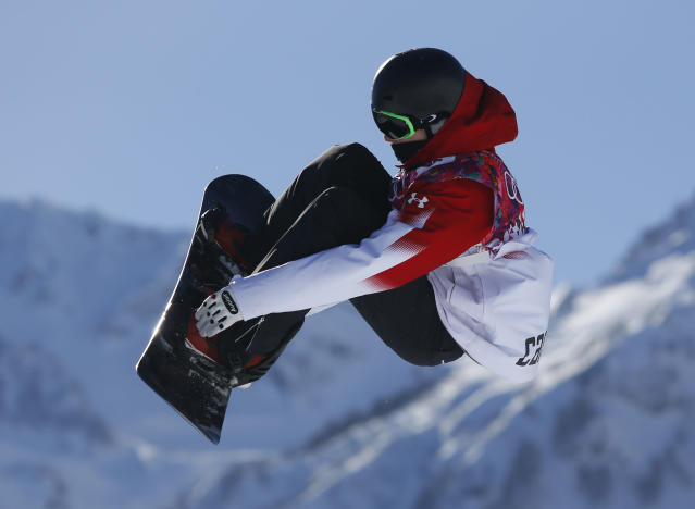Canada's Maxence Parrot takes a jump during the men's snowboard slopestyle qualifying at the Rosa Khutor Extreme Park ahead of the 2014 Winter Olympics, Thursday, Feb. 6, 2014, in Krasnaya Polyana, Russia. (AP Photo/Sergei Grits)