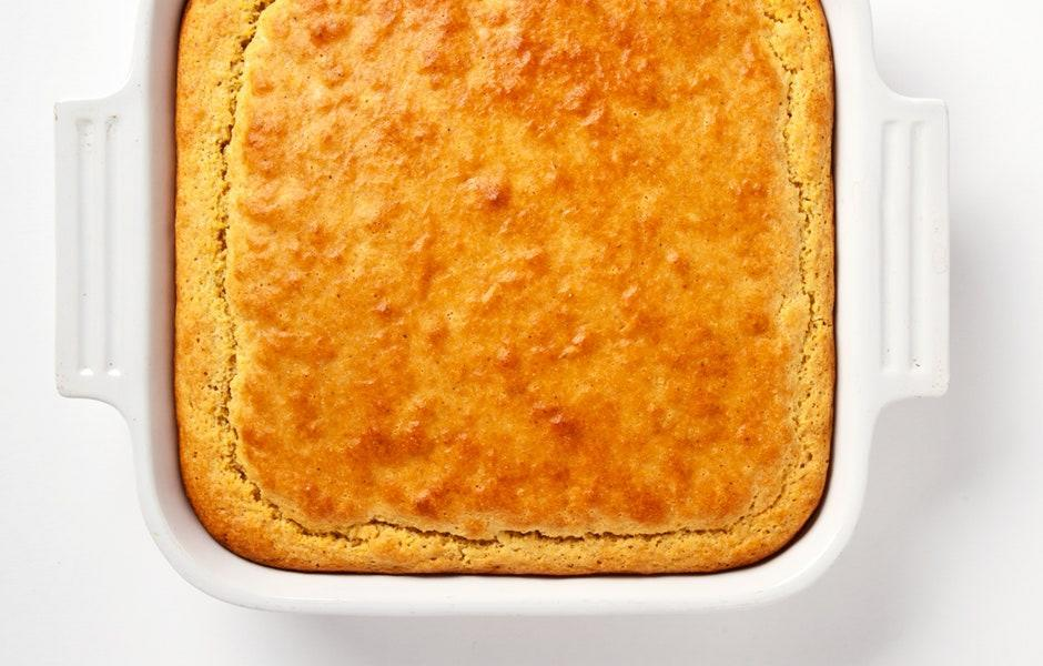 "A simple, straightforward cornbread that we'd happily serve alongside a bowl of chili on any other day of the year. <a href=""https://www.bonappetit.com/recipe/easy-savory-cornbread?mbid=synd_yahoo_rss"" rel=""nofollow noopener"" target=""_blank"" data-ylk=""slk:See recipe."" class=""link rapid-noclick-resp"">See recipe.</a>"