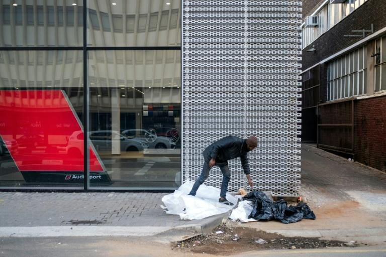 A heroin addict who lives on the street and hustles for money to support his drug habit, one of over 100,000 South Africans estimated to be addicted (AFP Photo/Wikus DE WET)