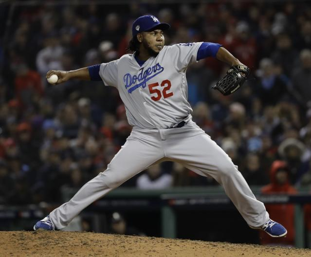 Los Angeles Dodgers' Pedro Baez throws during the seventh inning of Game 1 of the World Series baseball game against the Boston Red Sox Tuesday, Oct. 23, 2018, in Boston. (AP Photo/Matt Slocum)