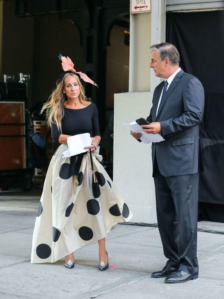 """<p>The reunion that half the fans of SATC wanted and half did not. While, according to rumours, their marriage might be on the rocks, we have to give it to the will-they-won't-they couple that the style credentials for these two are not rocky.</p><p>SJP was looking very Carrie-esque in an extravagant feather headdress, a bodice by capezio, a Carolina Hererra oversize polka dot skirt and Duchessa Gardini shoes according to <a href=""""https://www.instagram.com/p/CSFGFBFIYsb/"""" rel=""""nofollow noopener"""" target=""""_blank"""" data-ylk=""""slk:@justlikethatcloset."""" class=""""link rapid-noclick-resp"""">@justlikethatcloset.</a> Mr Big was suited and booted as ever.</p><p><a class=""""link rapid-noclick-resp"""" href=""""https://www.net-a-porter.com/en-gb/shop/product/carolina-herrera/clothing/midi/tiered-polka-dot-silk-midi-skirt/25458910981946198"""" rel=""""nofollow noopener"""" target=""""_blank"""" data-ylk=""""slk:SHOP SIMILAR"""">SHOP SIMILAR </a>Carolina Herrera tiered polka-dot midi skirt, £1,300<br></p>"""