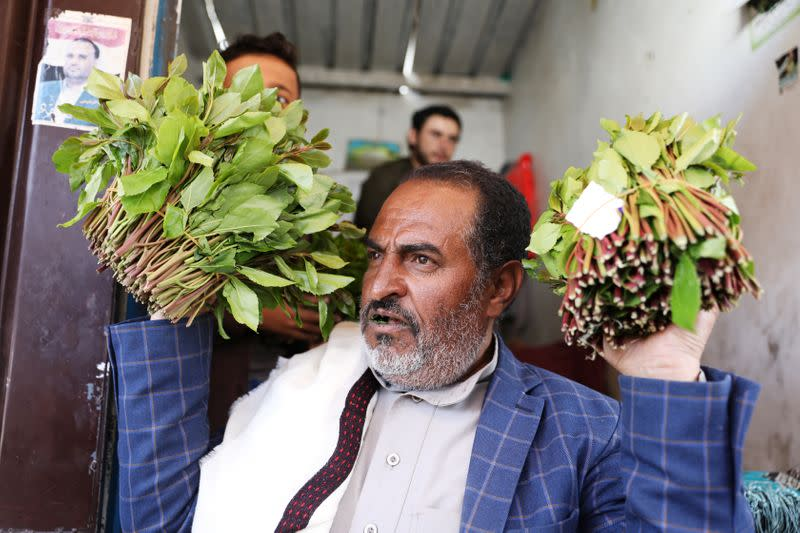 Vendor shows qat, a mild stimulant, at a qat market amid concerns of the spread of the coronavirus disease (COVID-19) in Sanaa